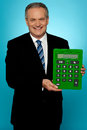 Senior manager showing big green calculator Royalty Free Stock Photography