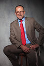 Senior manager wearing glasses posing seated Royalty Free Stock Photo