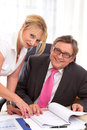 Senior managing director with his secretary at desk boss flirt work Stock Images