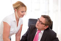 Senior managing director with his secretary at desk boss flirt work Stock Photos