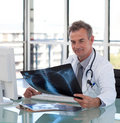 Senior Mature Doctor working Royalty Free Stock Photo