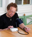 Senior measure blood pressure Stock Images