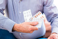 Senior medicate with pills at home old man taking too much medicaments Royalty Free Stock Photo