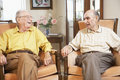 Senior men relaxing in armchairs Royalty Free Stock Photo