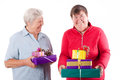 Senior and mental disabled woman holding gift Royalty Free Stock Photography