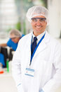 Senior microbiology specialist smiling in laboratory Stock Image