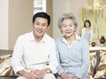 Senior mother and adult son home portrait of asian Stock Photos