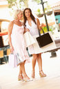 Senior Mother And Daughter Enjoying Shopping Trip Royalty Free Stock Photography