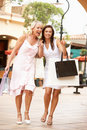 Senior Mother And Daughter Enjoying Shopping Trip Royalty Free Stock Images