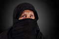 Senior muslim woman with black hijab dramatic portrait of niqab and Stock Images