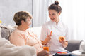 Senior and nice accompany good meal talk with caregiver Royalty Free Stock Image