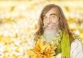 Senior old man portrait, autumn maple leaves, citi Royalty Free Stock Photo