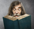Senior Old Man Read Book, Amazing Face Crazy Shocked Eyes Royalty Free Stock Photo