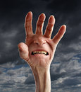Senior pain and suffering distress with the hand of an old retired person a screaming facial expression on the palm as a Royalty Free Stock Photography