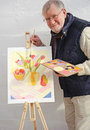 Senior painting tulips in oil on canvas Stock Image