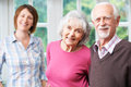 Senior Parents With Adult Daughter At Home Royalty Free Stock Photo