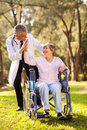 Senior patient caregiver cheerful doing high five with friendly outdoors Stock Photo