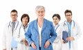 Senior patient in front of medical team happy female standing smiling looking at camera isolated on white Royalty Free Stock Photos