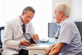 Senior Patient Having Consultation With Doctor In Office Royalty Free Stock Photo