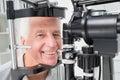 Senior patient using slit lamp at clinic portrait of happy Stock Image