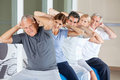 Senior people doing back exercises Stock Photography