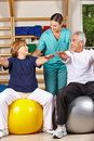 Senior people doing back fitness Stock Photography