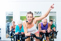Senior people in gym spinning on fitness bike Royalty Free Stock Photo