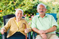 Senior people mother and son sitting on chairs in the garden of the nursing home Royalty Free Stock Photography