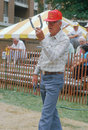 A senior playing a game of horseshoes Royalty Free Stock Photo