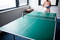 Senior playing ping pong in the retirement house Stock Images