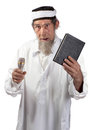 Senior preacher a with a microphone and book delivers a message Royalty Free Stock Image