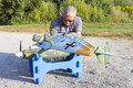 Senior rc modeller and his new plane model assembling Royalty Free Stock Image