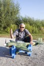 Senior rc modeller and his new plane model preparing to takeoff Stock Photos