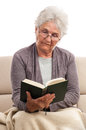 Senior reading book high emotional level old woman a at isolated on white background Stock Photography
