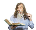 Senior reading book. Old man education, elder with beard Royalty Free Stock Photo
