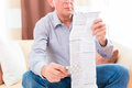 Senior reading medicament package insert at home old man with glasses Stock Photography