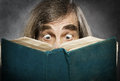 Senior reading open book surprised old man amazi amazing eyes looking blank cover Royalty Free Stock Image
