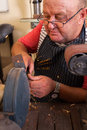 Senior repairman grinding using machine in workshop Royalty Free Stock Images