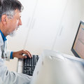 Senior researcher using a computer in the lab while working on an experiment color toned image Stock Photos