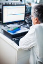 Senior researcher using a computer in the lab while working on an experiment color toned image Royalty Free Stock Image