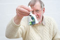 Senior ringing a bell to call for attention. Royalty Free Stock Photo