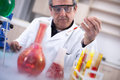 Senior scientist with protective glasess researching in laborato Royalty Free Stock Photo