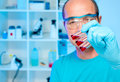 Senior scientist with samples in gloved hand Stock Photography