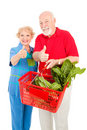 Senior Shoppers Give Thumbs Up Stock Image