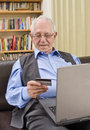 Senior shopping online Stock Image