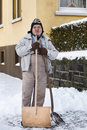 Senior Shovelling Snow Stock Photography