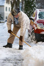 Senior Shovelling Snow Royalty Free Stock Photography