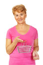 Senior smiling woman holding mini shopping basket Royalty Free Stock Photo