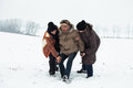 Senior snow accident and people helping him couple of young to men stand up after on in winter Royalty Free Stock Photos