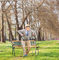 Senior standing up with walker in park shot tilt and shift lens Royalty Free Stock Images